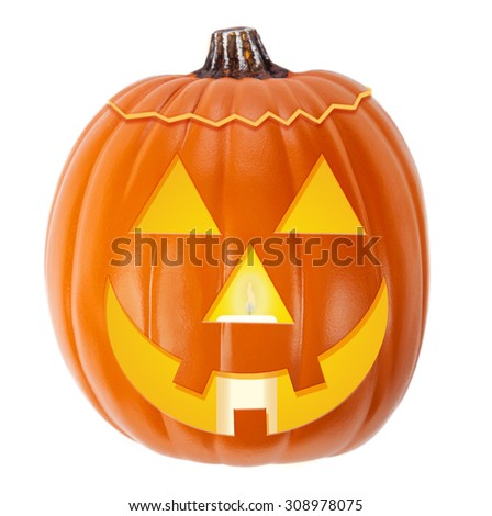 Jack-O-Lantern Halloween pumpkin with a happy face and a cit candle - stock photo