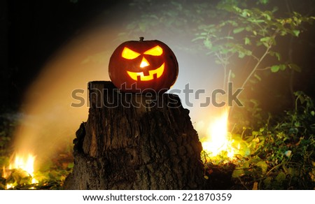 Jack O Lantern Halloween pumpkins in darkness - stock photo