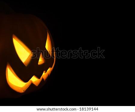 Jack-o-lantern isolated on a black background - stock photo