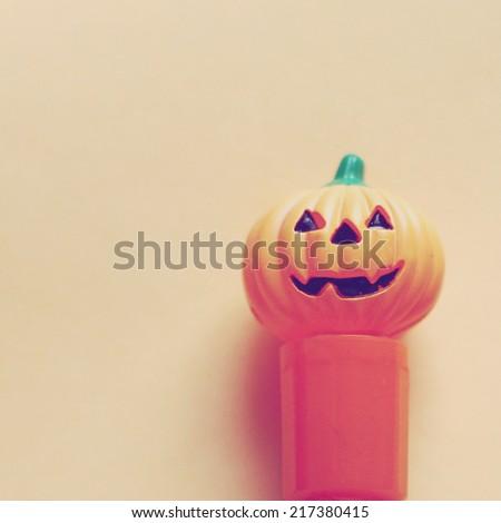 Jack o lantern pumpkin on paper with retro instagram filter effect  - stock photo