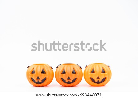 Jack o'lantern pumpkinhead plastic on white background used for decorations on halloween day.Theme Halloween background.