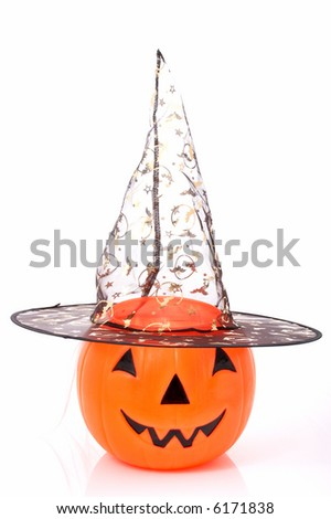 Jack o lantern wearing a witch hat over a white background
