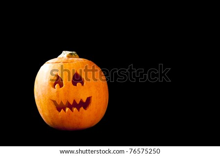 Jack-o-lantern with flame eyes and jagged teeth - stock photo
