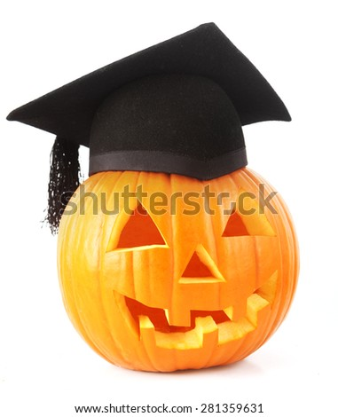jack o lantern with mortar board - stock photo
