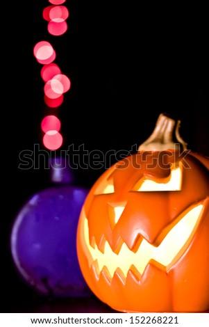 Jack-O-Lantern with mysterious potion - stock photo