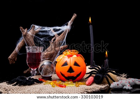 Jack-o'-lanterns and spider web with halloween decoration