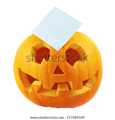 Jack-o'-lanterns pumpkin with a copyspace paper sticker over it isolated over white background - stock photo