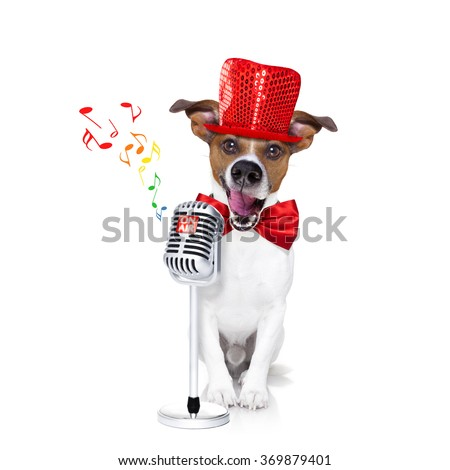 jack russell dog , singing a karaoke song or reading the news using a retro mic or microphone, party hat and red tie, isolated on white background - stock photo