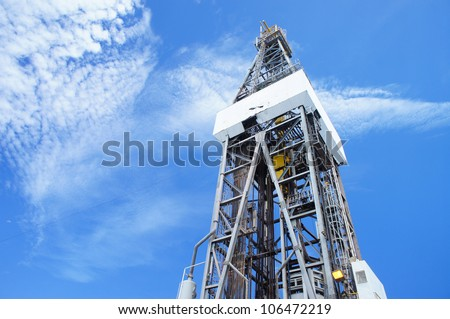 Jack up Drilling Rig Derrick on Sunny Day - stock photo