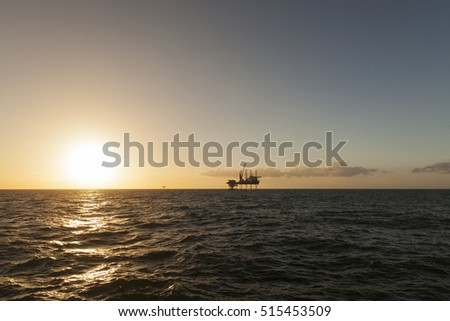 Jack Up heavy lift ship at sunset