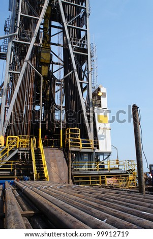 Jack Up Offshore Drilling Rig With Casing Laying On The Cantilever Deck - stock photo