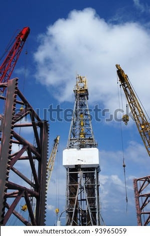 Jack Up Offshore Drilling Rig With Rig Cranes on Sunny Day - The View From The Bow Leg