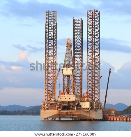 Jack up oil drilling rig in the shipyard for maintenance - stock photo