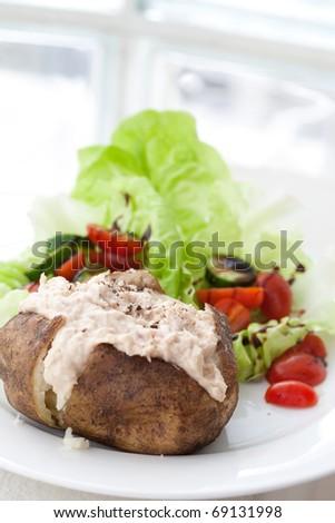 Jacket potato with tuna and fresh salad - stock photo