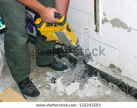 Jackhammer in the worker hands - stock photo