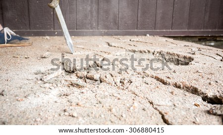 Jackhammer working on the construction site . - stock photo