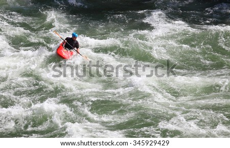 Jackson, Wyoming, USA  July 22, 2014 An experienced kayaker challenges the rapids of the South Fork of the Snake River, near Jackson, Wyoming.
