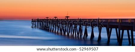 jacksonville beach, florida pier at sunrise - stock photo