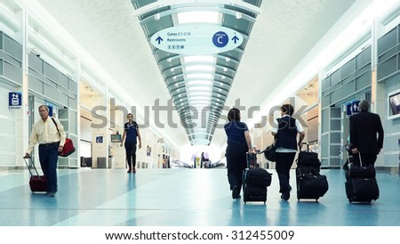 JACKSONVILLE, FLORIDA - AUGUST 30, 2015: Inside the Jacksonville International Airport. The Jacksonville Airport is a civil-military public airport 13 miles north of downtown Jacksonville.  - stock photo