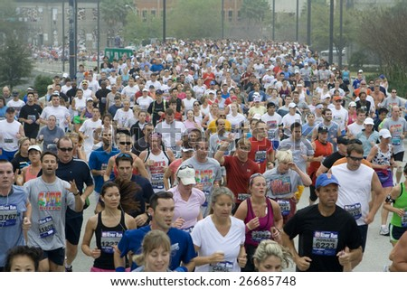 JACKSONVILLE, FLORIDA - MARCH 14: Start of the Gate River Run in Downtown Jacksonville, Florida on March 14, 2009. - stock photo