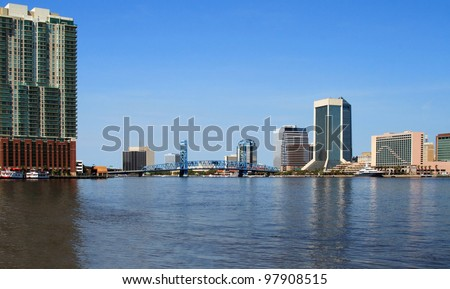Jacksonville Florida skyline and the St Johns River - stock photo