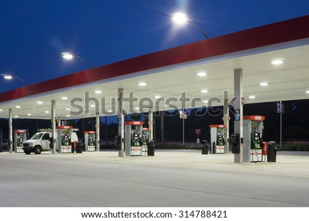 JACKSONVILLE, FLORIDA, USA - AUGUST 5, 2015: A Gate Petroleum gas station at night. Gate Petroleum is headquartered in Jacksonville and has over 225 stations in six states with over 2,200 employees. - stock photo