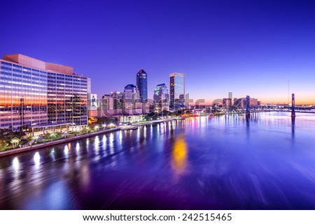 Jacksonville, Florida, USA city skyline on St. Johns River at dawn.