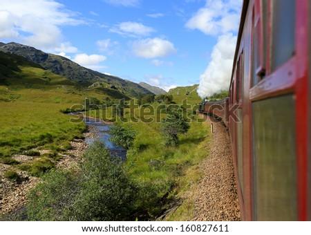 Jacobite stream train, Glenfinnan Viaduct, Scotland, UK - stock photo