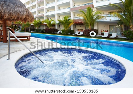 Jacuzzi and a swimming pool at caribbean resort. - stock photo