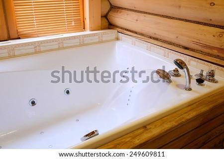 Jacuzzi bath in hotel - stock photo