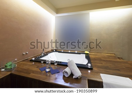 Jacuzzi bath in modern hotel spa center  - stock photo