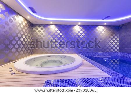 Jacuzzi bath in spa wellness center - stock photo