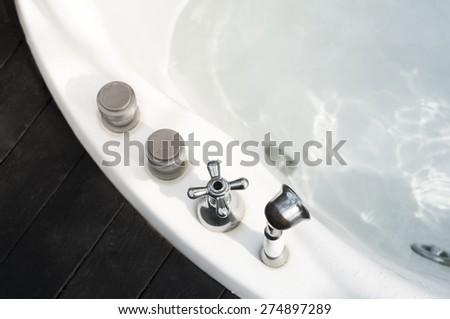 Jacuzzi bath tub control button and foucet valve - stock photo