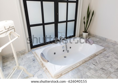 jacuzzi bath. jacuzzi bath tub on marble floor with water Whirlpool Bath Stock Images  Royalty Free Vectors