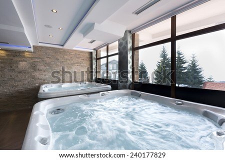 Jacuzzi baths in hotel spa center  - stock photo