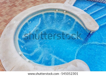 Jacuzzi for massage, built-in pool. Outdoors Blue water