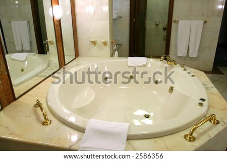 Jacuzzi in modern bathroom - stock photo