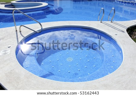 jacuzzi outdoor blue swimming pool summer vacation - stock photo