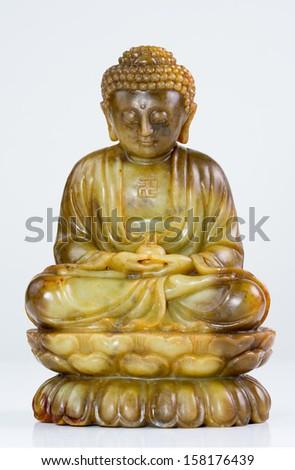 Jade Buddha meditation statue - stock photo