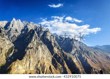 Jade Dragon Snow Mountain. Taken from Hiking path (the high road) of Tiger Leaping Gorge. Located 60 kilometres north of Lijiang City, Yunnan Province, China. - stock photo