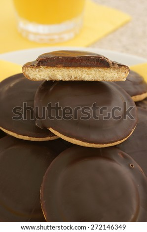 Jaffa cakes a sponge base cake with a layer of orange flavoured jelly coated with chocolate - stock photo