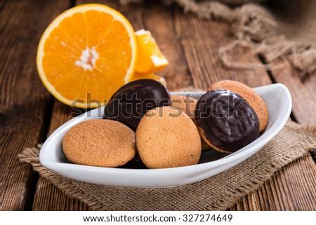 Jaffa Cakes (Orange) as close-up shot on wooden background - stock photo