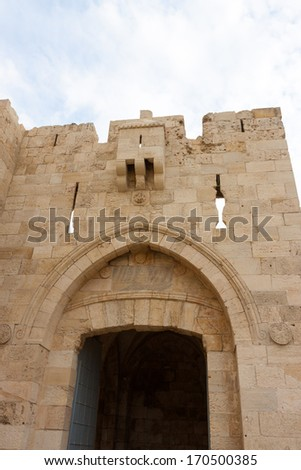 Jaffa gate in a wall of old city Jerusalem - stock photo