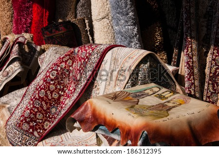 JAFFA, ISRAEL - FEBRUARY 18, 2014: Oriental carpets and a rug with portraits of  prophet Moses (Moshe Rabbenu) and his brother Aaron (first High Priest) besides the Tablets of Law at the flea market . - stock photo