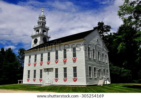 Jaffrey Center, New Hampshire - July 11, 2013:  Red, white, and blue patriotic bunting decorates the windows at the 1775 Original Meeting House church with its elegant steeple and bell tower *