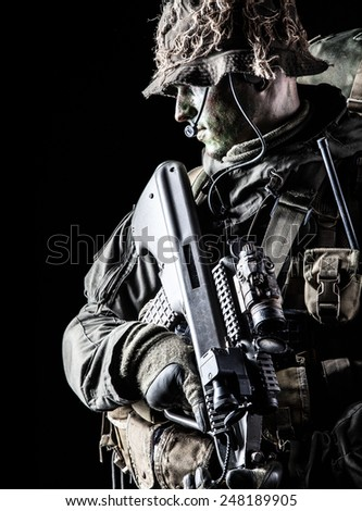 Jagdkommando soldier Austrian special forces with rifle on dark background - stock photo