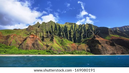 Jagged hills from catamaran at the dramatic Na Pali coast of Kauai, Hawaii Islands. - stock photo