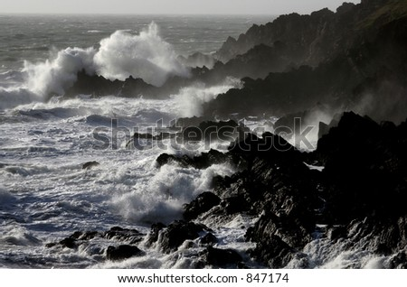Jagged Rocks off the Welsh Coast in Pembrokeshire - stock photo