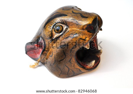 jaguar head carved in wood - stock photo