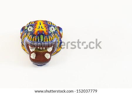 Jaguar head made in Mexico. Huichol artcrafts. - stock photo